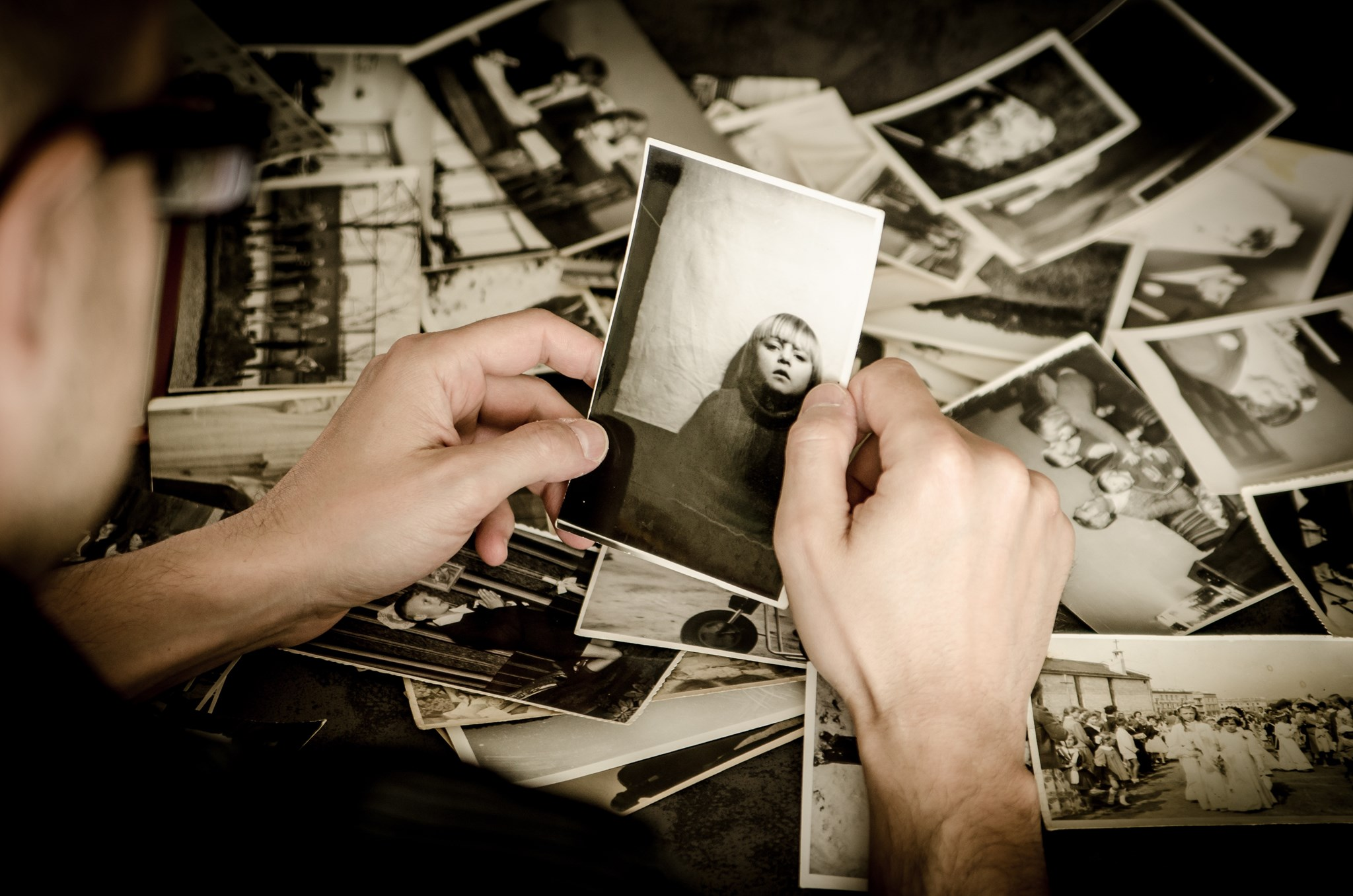 Man looking at old black and white photos